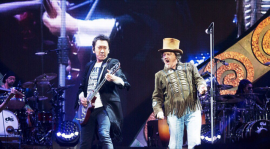 Hotei performs with Zucchero in Arena Di Verona, Italy